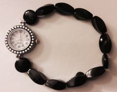 A personal favorite from my Etsy shop https://www.etsy.com/listing/228895231/classic-black-beaded-watch-black-onyx
