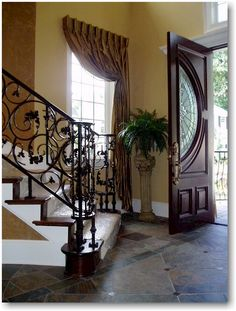 one panel window treatment ideas | Panel sets the stage for an elegant foyer of the Kaslo. This treatment ...