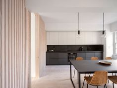 London-based firm Proctor & Shaw has completed a pared-back yet stylish renovation of a central London flat. The defining feature of 'Marylebone Apartment' is. Timber Walls, Wooden Walls, London Apartment Interior, London Architecture, Residential Architecture, Minimalist Apartment, Minimalist Kitchen, House Extensions, Building A House