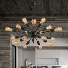"""Noemi 14-Light Sputnik Chandelier - Versatile and stylish, this Noemi metal Edison Chandelier will light up your home with 14 bulbs. Hang this chandelier in your ceiling for a decorative yet functional piece that adds unique style. This stunning light will complement your home decor and has a total height of about 20""""."""