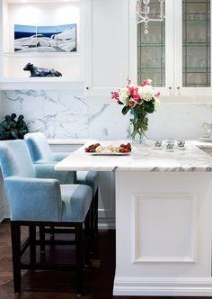 kitchens - blue counter stools white glass-front kitchen cabinets kitchen island peninsula marble slab backsplash Gorgeous breakfast bar with