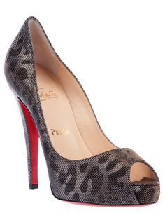 Christian Louboutin leapoard print open toe heels.....not that I would but I could;)