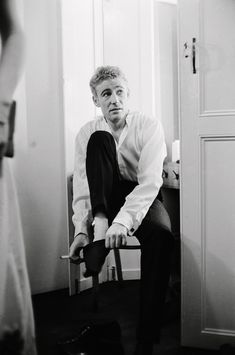 Peter O'Toole, opening night of Hamlet at the Old Vic (1963)  22nd October 1963: Irish actor Peter O'Toole dons his socks for the opening night of 'Hamlet' at the Old Vic. This was the inaugural production of the National Theatre Company, with Laurence Olivier as its director.
