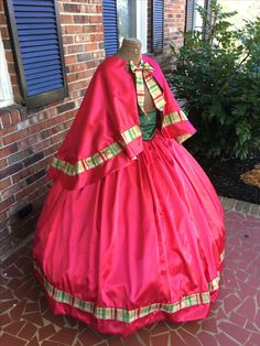 Red Satin Mrs Clause dress/Dickens Fair Costume.   http://www.cumberlandriversutlery.com/red-satin-wgold-plaid-trim-dickens-costumecivil-war-dress.html