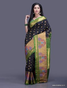 Very opulent even for a Paithani, this saree with a broad ornate border depicting intricate peacock and lotus design is a masterpiece. Paithani silk uses the ancient technique of tapestry where multiple threads of different colours along with gold and silver threads are weaved together to form a fascinating piece of silk.