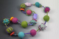 Beads with wool balls , felt jewellery accessory inspiration MadDesigns: felted ball necklace Jewelry Crafts, Jewelry Art, Beaded Jewelry, Handmade Jewelry, Textile Jewelry, Fabric Jewelry, Colar Boho, Felt Necklace, Felt Brooch