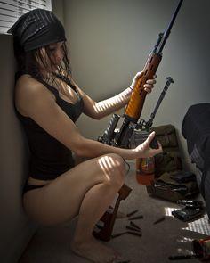 """Female assassin loads her Dragunov (SVD-63), officially """"Sniper Rifle,"""