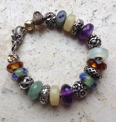 Trollbeads-Antique flowers, stones and ambers... and the tulip lock....I so want to start one of these!