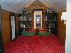 Behind the faux bookcase doors by Movable House, via Flickr