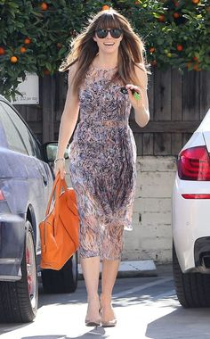 Mr. Timberlake's beautiful wifey Jessica Biel headed to a baby shower in Hollywood wearing a  flowy, springtime dress and oversized, blacked-out shades!