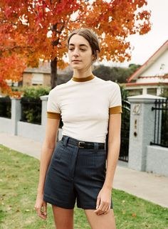 The Thea T is a comfortable, slim fitting t-shirt finished with neck and sleeve bands. This top is long enough to be tucked into mid to high waist pants Made in Melbourne - Australia Colour ;  cream with gold bands Fabric ; mid weight jersey, slightly transparent. Made from 100% luxurious Merino Woo