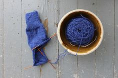 Picking up stitches for cuff-down sock gussets can be tricky! Find out where to put your needle to pick up those stitches.