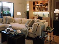 A large sectional sofa provides space for unwinding after a hard day's work at the concealed closet office space.  Like the built-ins...something to consider for future.