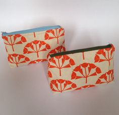 Screen printed 'Hydrangea' wash bags in tangerine