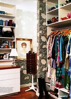 open wardrobe, shelves, and vibrant wallpaper love!