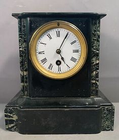 This is a nice looking 100+-year-old late 19thC marble mantle clock featuring a nicely aged original finish with a single tiny chip to the left bottom corner edge. No key or pendulum is present. This clock displays very nicely and appears to be unmarked.