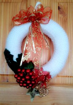 White Hand-Knitted Christmas Wreath decorated with Silk flowers, artificial berries & wired ribbon.