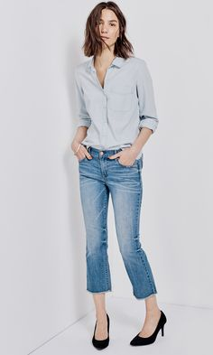 For your casual Fridays: Tuck a structured button down into a pair of flared jeans with a cropped hem. Roll your sleeves to show off a wrist full of bangles, and slip into a pair of sueded pumps for a sophisticated edge. The results: an effortlessly chic look that's very much on trend.