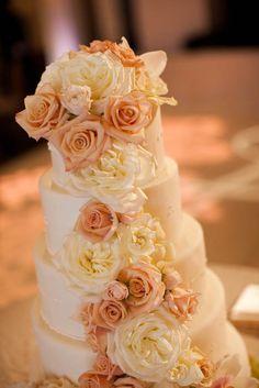 Wedding cake.  Fresh flowers