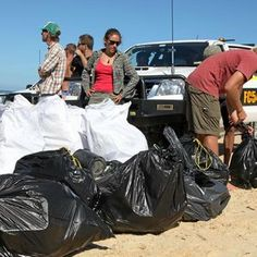 USC students and staff members collect more than a tonne of rubbish from a 30km stretch between the southern tip of Fraser Island and Eurong