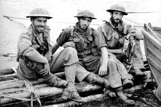 """""""Three Australian soldiers of the of the 2/14th Infantry Battalion, Second Australian Imperial Force photographed after rescue. The three soldiers were cut off from the main body of Australian troops engaging the Imperial Japanese Army near Myola during the withdrawal across the Owen Stanley Range in Papua New Guinea. Kalikodobu (Karekodobu), Central Province, Papua New Guinea. October 1942."""""""