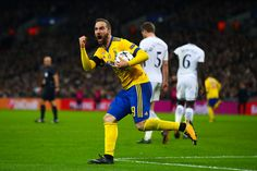 Gonzalo Higuain of Juventus celebrates after scoring the equalising goal during the UEFA Champions League Round of 16 Second Leg match between Tottenham Hotspur and Juventus at Wembley Stadium on March 7, 2018 in London, United Kingdom. - 94 of 146