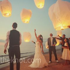 Floating Lanterns to be released at the end of the reception!  It reminds us of the Disney movies Tangled! :)