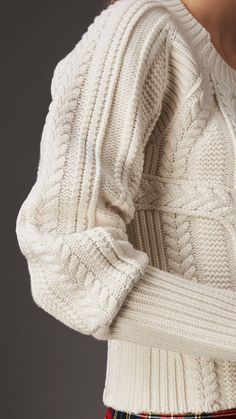 A sweater textured with multi-stitch cable-knits in wool and cashmere. Finished with a chunky ribbed trim, an elongated cuff shapes the enveloping design at the wrist. Pair with runway-inspired tartan or denim for off-duty days. Wooly Jumper, Cable Sweater, Knitwear Fashion, Knit Fashion, Girls Sweaters, Cardigans For Women, Cable Knitting, Knit Picks, Sweater Design