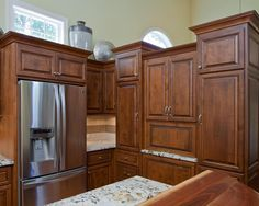 Beautiful wood cabinetry offers a warm, traditional sense to this open layout kitchen.
