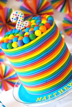 Kids rainbow birthday cake. Check out these other kids birthday party ideas too: http://www.under5s.co.nz/shop/Hot+Topics/Activities/Birthday+Parties.html
