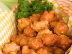 Golden Corn Fritters Recipe | Nothing puts a smile on a Southerner's face like deliciously crisp golden corn fritters fresh out of the fryer. This recipe is undeniably simple and oh-so tasty. With less than 10 ingredients, corn fritters are the perfect choice for a scrumptious and last minute side dish. This recipe came to us from Lynne Weeks in Midland, Georgia, back in the 1980s, and it has stood the test of time with our readers ever since. The flavorful finger food is complete with milk,