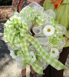 Spring lime green deco mesh wreath with daisies and plaid burlap ribbon.