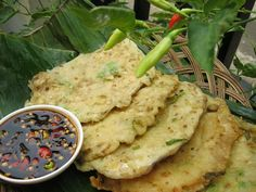 Tempe Mendoan is a kind of tempeh cooking that is made from thin tempeh, fried with flour so as to taste deliciously piquant. Traditionally in the Banyumas territory, tempe mendoan was made from thin, wide tempeh, one or two sheets cooked at a time. However, tempe mendoan also could be made from normal tempeh that was sliced very thin but wide. http://www.goindonesia.com/id/indonesia/jawa/purwokerto/makanan/tradisional/tempe_mendoan