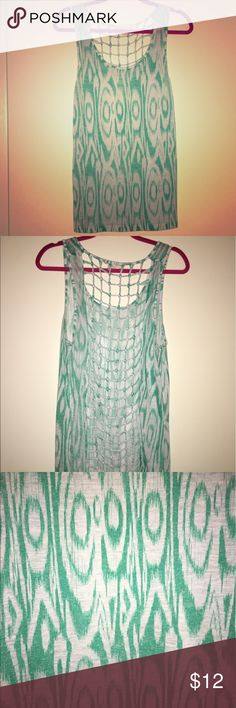Mint / White Tank Top Lightweight, patterned tank in mint / white with mesh cutout back. Would look great with denim shorts / flats, or over a swimsuit. Only worn once, in excellent condition. Feel free to browse my closet, I offer a great bundling discount! Staring at Stars Tops Tank Tops