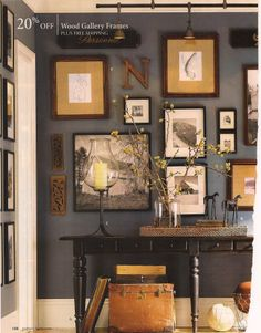 love the mix of frames and found items...ya know I love this...even looks like me...I even like the darker grey on the walls....what do you think?  Darker grey in living room or red garnet as an accent wall behind fireplace?