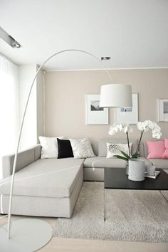 Beige living room with a pop of pink throw pillows.
