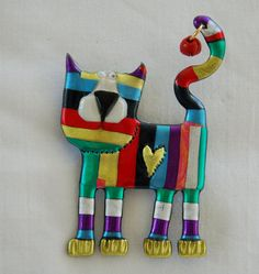 Colored striped cat pin with coral, purple, and dark blue with red bell