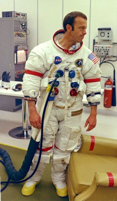 Spacesuits used by the Apollo astronauts were no longer air-cooled. A nylon undergarment mesh allowed the astronaut's body to be cooled with water - similar to way a radiator cools a car's engine.  Additional layers of fabric allowed for better pressurization and additional heat protection.  Astronaut Alan B. Shepard Jr. undergoes suiting up operations at the Kennedy Space Center during the Apollo 14 prelaunch countdown. Shepard is the commander of the Apollo 14 lunar landing mission.
