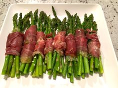 Prosciutto Wrapped Asparagus.   Great way to eat your greens; it's light and easy to make.   MarkLauren.com