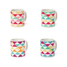 A complete set of Triangle Mugs in all four colourways - Yellow, Green, Blue and Purple. Stylish yet simple and a great set of a contemporary kitchen.    Designed and made in the UK. From Howkapow