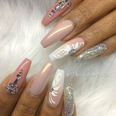 Coffin shaped, all shades of nude and some silver glitter! Rhinestones design with white floral detailing! Beautiful nails by @nailsbyquetel Ugly Duckling Nails page is dedicated to promoting quality, inspirational nails created by International Nail Art
