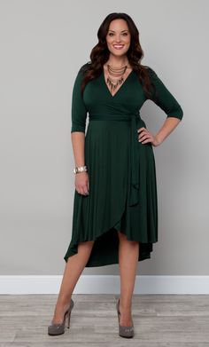 You'll love this soft jersey plus size wrap dress.  Our Winona Hi-Lo Wrap Dress is a classic silhouette with a chic twist.  The front of the skirt hits higher then the back hem, giving you feminine movement and charm. #KiyonnaPlusYou #Plussize