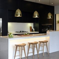Carlene and Michael | Room 6 | Kitchen | The Block Shop - Channel 9. Gold pendant lights against the black.