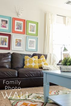 This Colorful family photo wall is an inspiration to get those pictures off printed! Family Gallery walls make a house feel like a home.