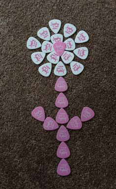 Personalized guitar picks scattered on guest tables around floral centerpieces. (My husband was my guitar teacher before we started dating.) They come in any color. Now I need to frame the extras and display in our house. Guitar Pick Art, Cool Guitar Picks, Bar Mitzvah Centerpieces, Floral Centerpieces, Guitar Picks Personalized, Quinceanera Ideas, Special Events, Guitars, Our Wedding