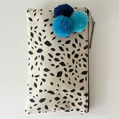 Hand screen printed canvas clutch purse, black print with removable pom pom brooch in shades of blue.  SALE!!! 40% off!!  Was $35 now $21 This
