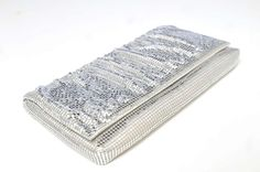 Silver clutch ($40); Fringe Boutique, 1055 Grand Ave., St. Paul; 651-292- 4943.