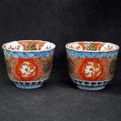 Matched pair of antique colorful porcelain Japanese Imari tea cups 19th century