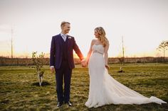Image by Jon Day Photography - A rustic outdoor spring barn wedding at South Farm in Cambridge with Denia by La Sposa wedding gown, blue and bright colour scheme and groom in Paul Smith suit