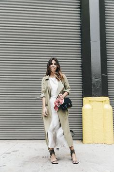 Long camel trenchcoat with white midi dress and black sandals | Image via collagevintage.com